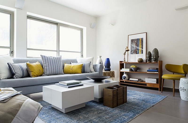 Plush couch in cool blue with yellow accent pillows