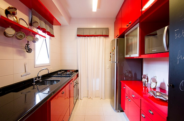 Red kitchen cabinets with black countertop for the modern kitchen