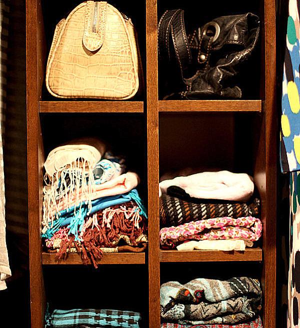 Shelves hold folded scarves