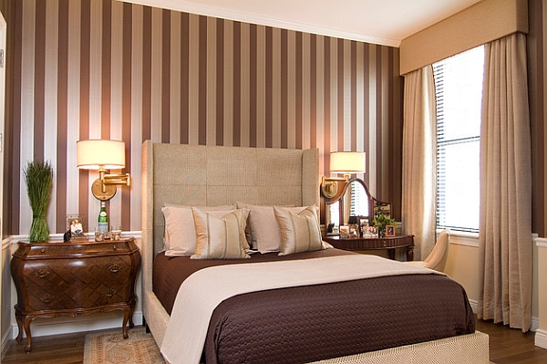 Silver and brown stripes blend in with the color scheme of the bedroom