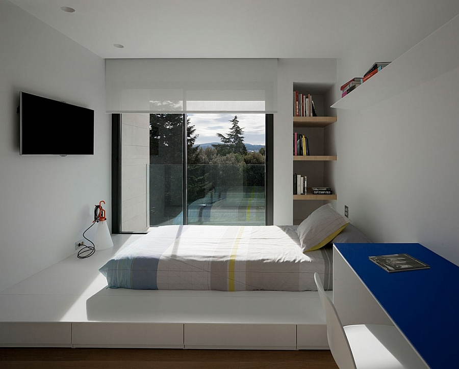 Sleek minimalist bedroom in white