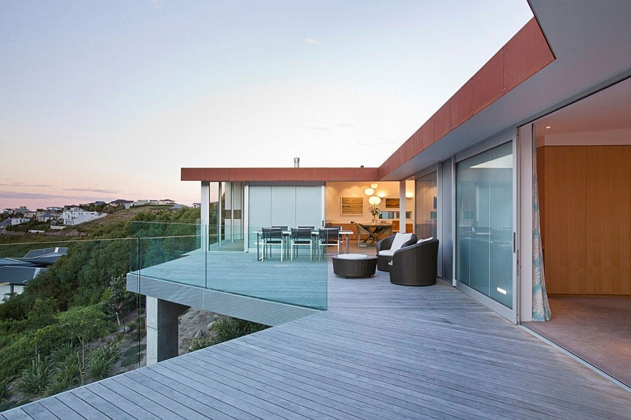 Spacious terrace with glass railing and ocean views