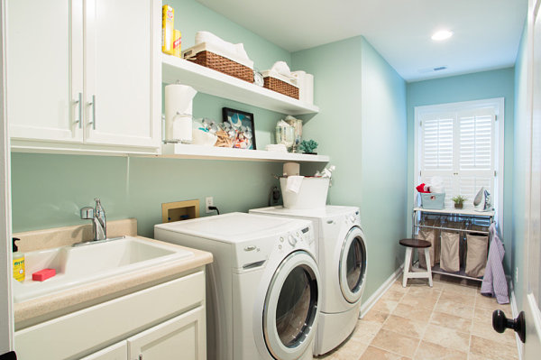 Storage and decor on laundry room shelves