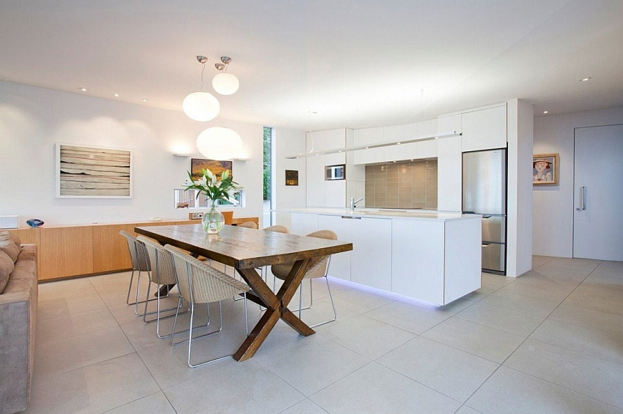 Stylish kitchen and dining room in white
