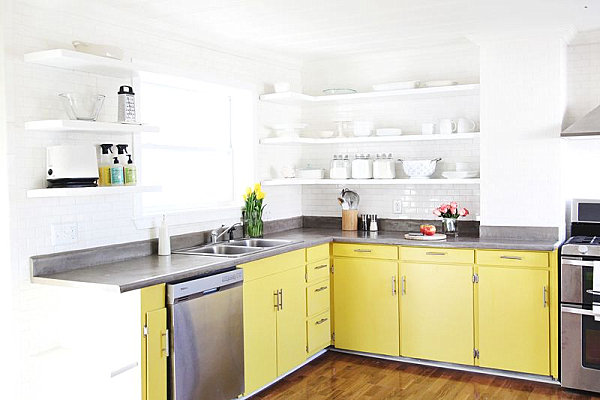 Sunny yellow cabinets in a crisp white kitchen