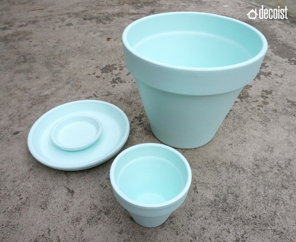 Terra-cotta pots with a blue base coat