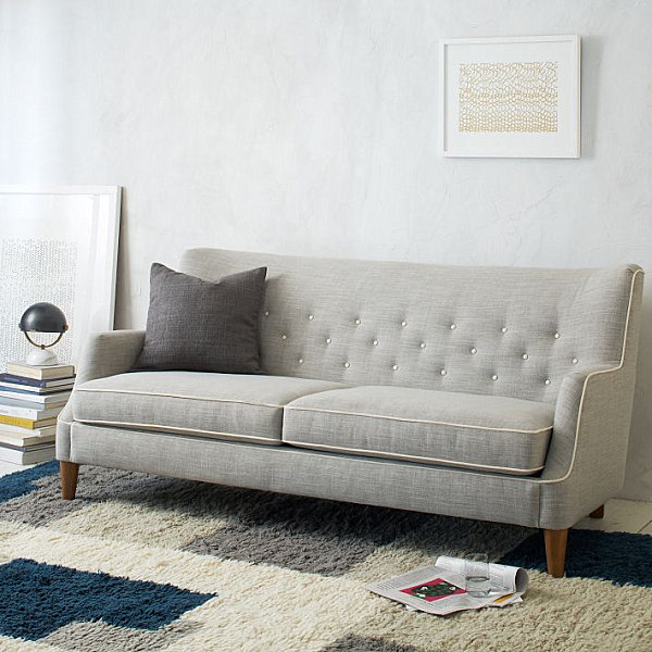 Tufted sofa with tapered legs