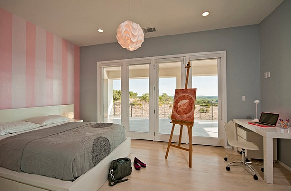 Vertical pink stripes add chic glam to the room