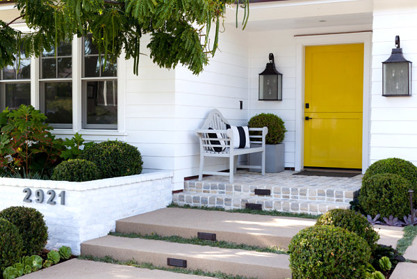 Wooden bench near a painted front door Refresh Your Homes Entrance With These Front Porch Makeover Ideas