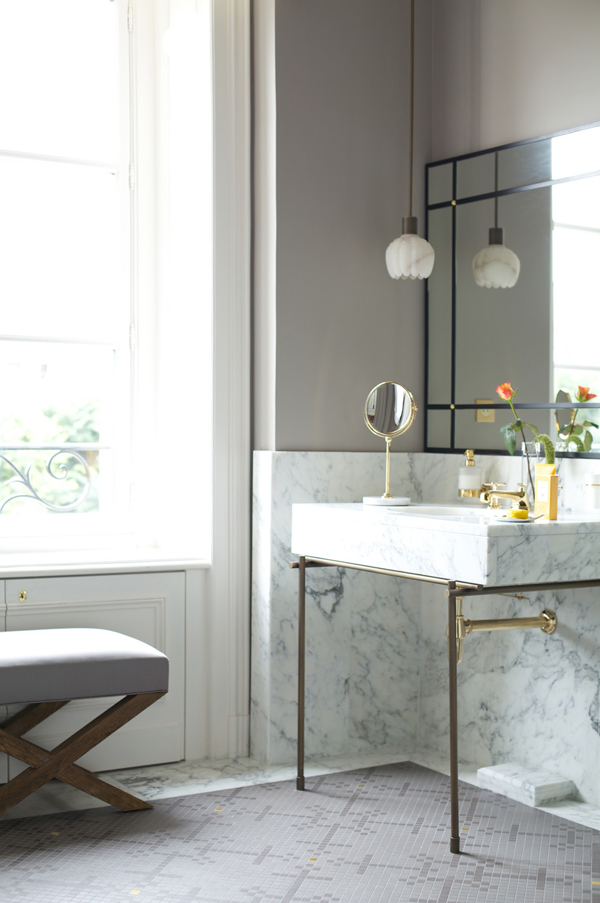 brass and marble bath