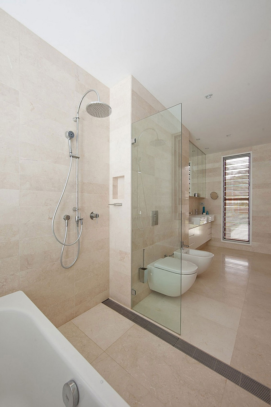 contemporary bath with a glass shower area