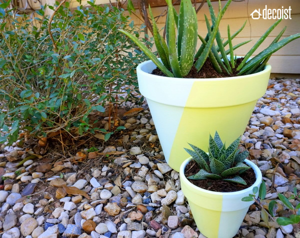 These painted geometric pots look great inside our outdoors