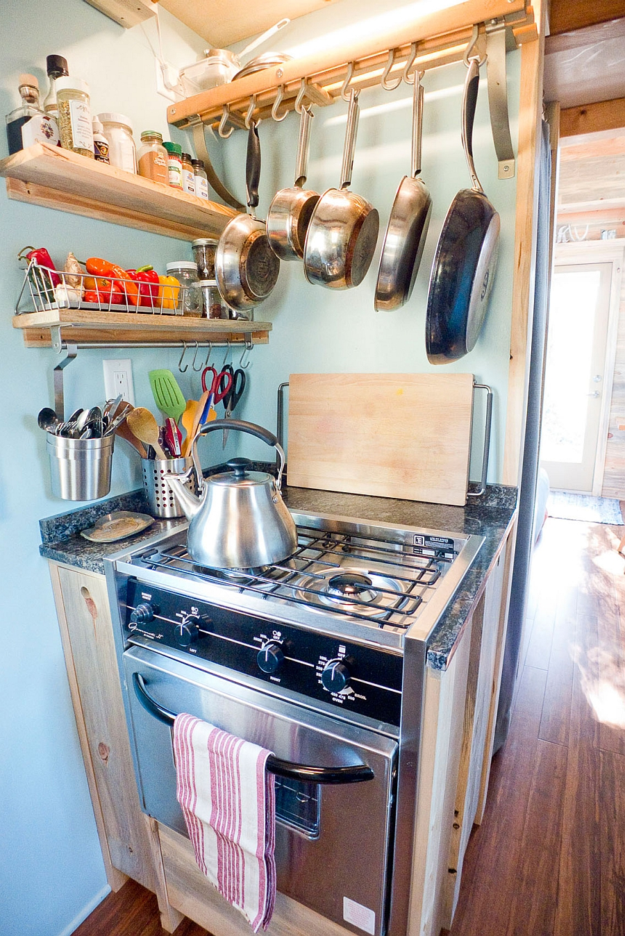 A pot rack saves up space in compact kitchens