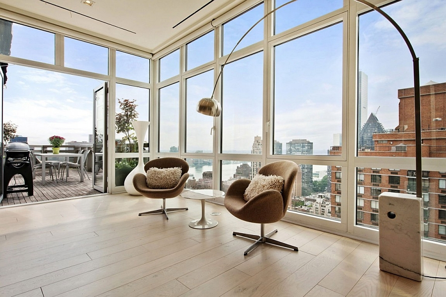 Arco floor lamp and swan chairs in the living room of NYC apartment