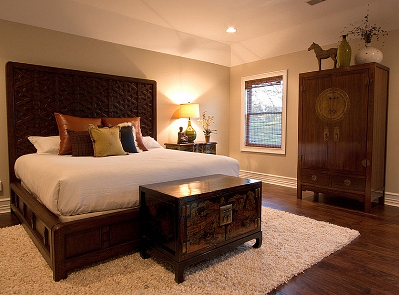 Asian Fusion style accentuated by the Ming cabinet at the foot of the bed