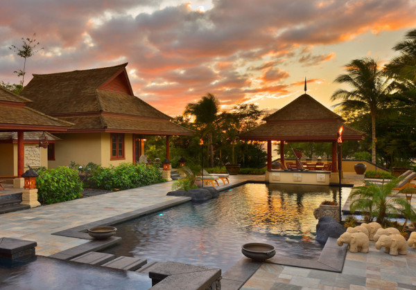 Balinese backyard pool and tribal bungalows