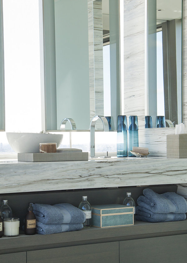 Bathroom shelving items in soothing colors