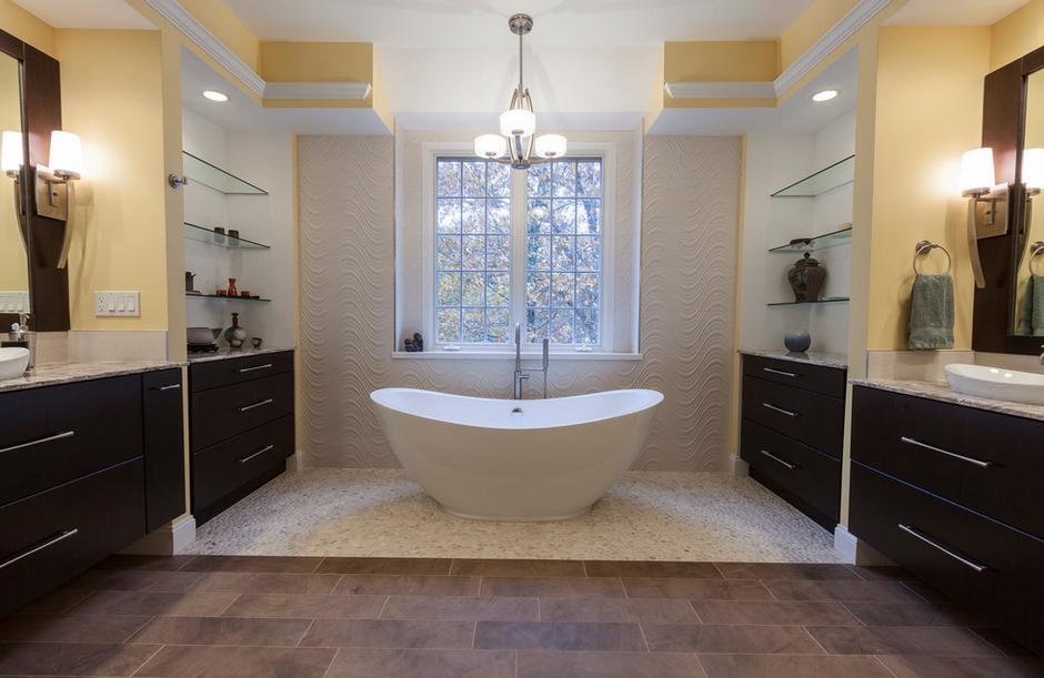 Beautiful yellow bathrom featuring a stand-alone bathtub