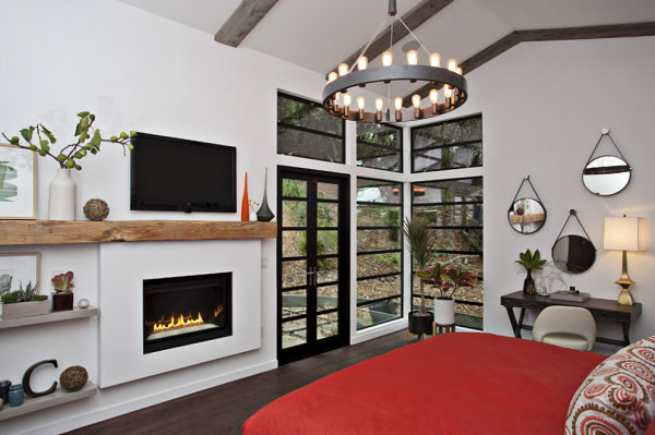 Bedroom with a wooded view and ample plant life