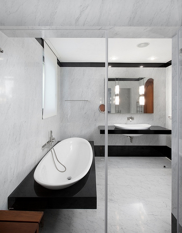 Black and white color scheme is perfect for minimalist bathrooms