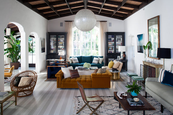 Blues, greens and neutrals in a living room designed by Nate Berkus