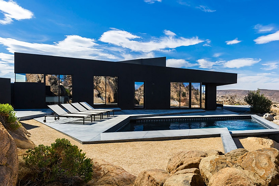 Bold design of the black desert house Stunning Silhouette and Spectacular Landscape Define The Black Desert House