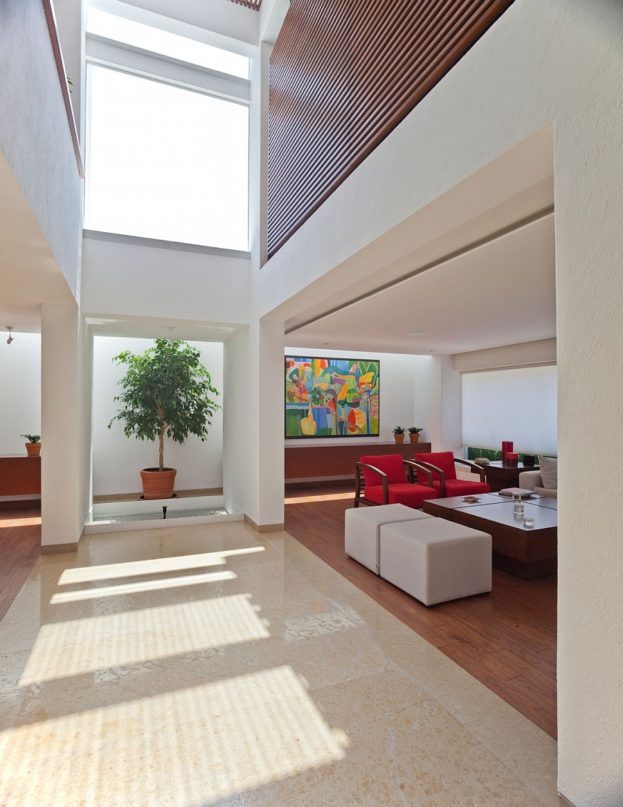Bright, colorful accents inside a white contemporary residence