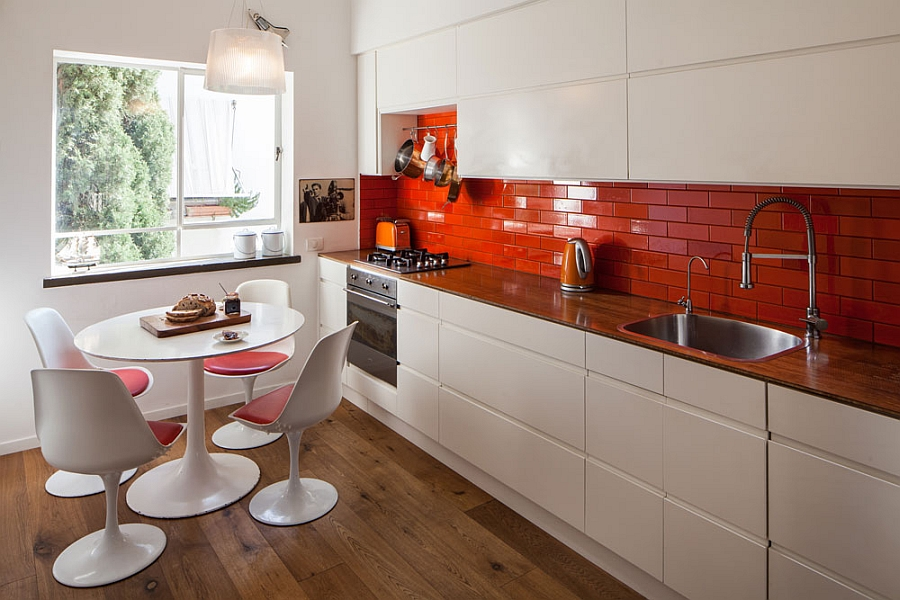 Bright orange backsplash in the kitchen