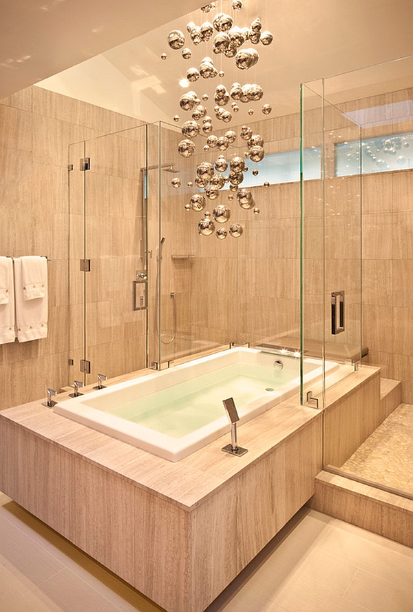 Cascading bubble chandelier in the bathroom blends with the backdrop