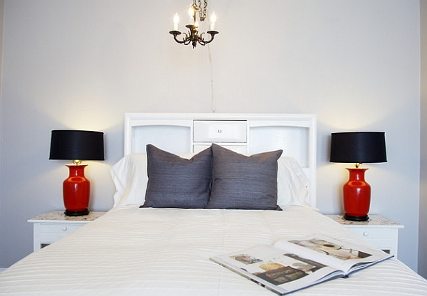 Charming black and red table lamps in a bedroom clad in white