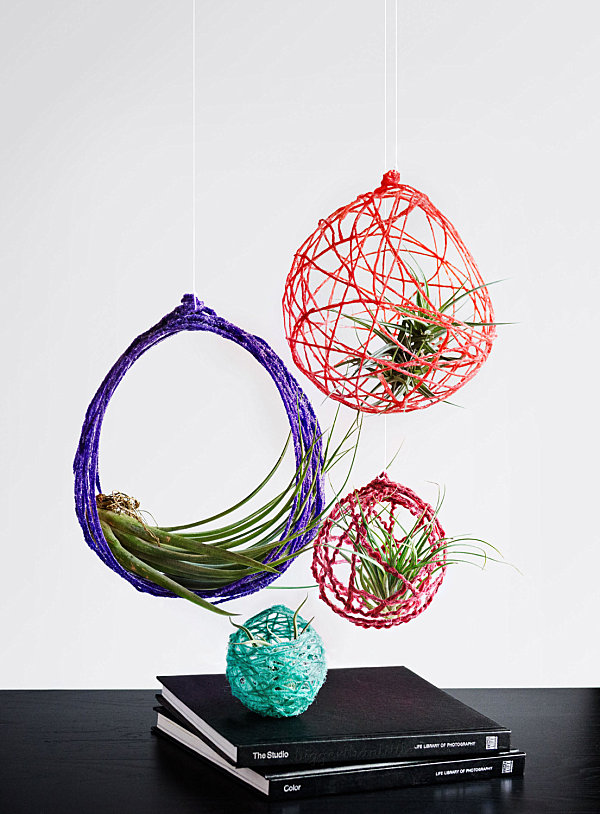 Colorful yarn hanging planters