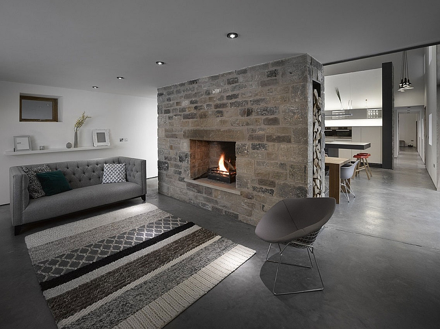 Cozy stone fireplace has a traditional appeal