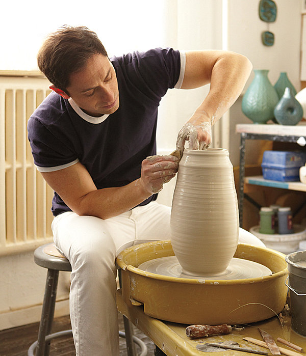 Designer Jonathan Adler at the potter's wheel