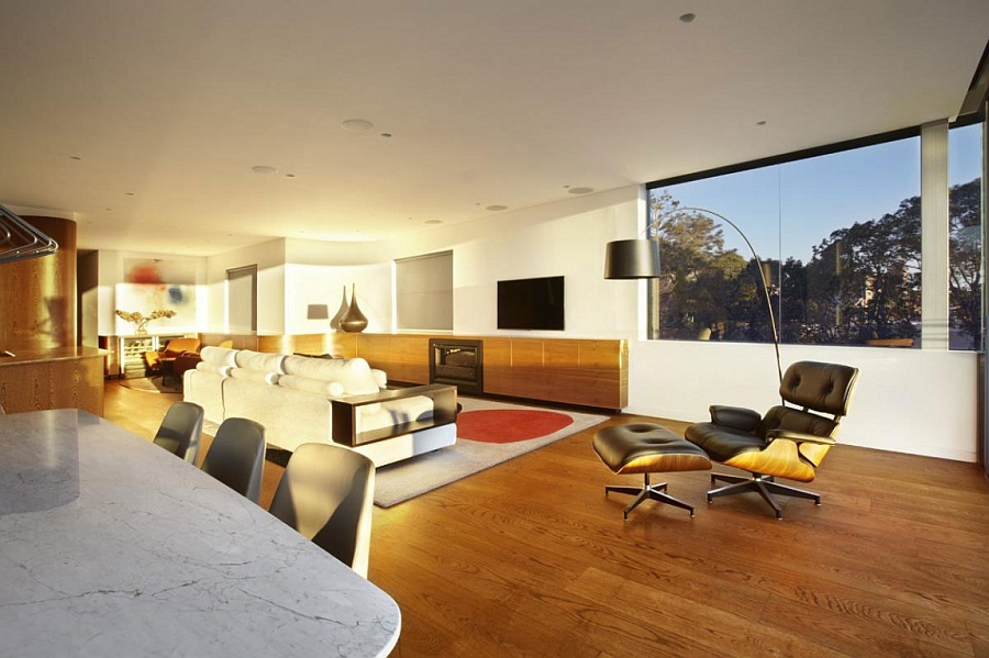 Eames Lounger in the living room Sweeping Views Of Sydney And Lovely Earth Tones Shape The Bellevue Hill House