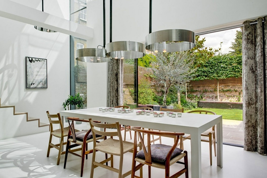 Elegant dining area visually connected to the backyard