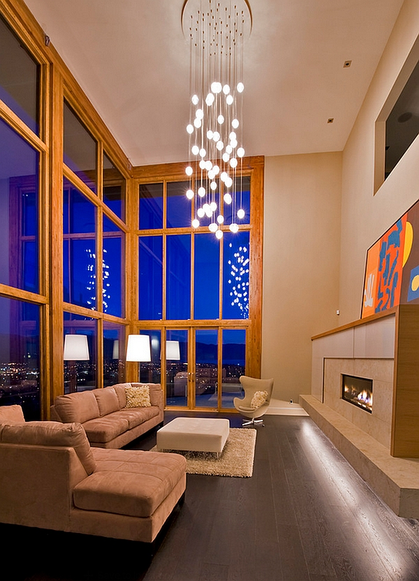 Elobarate cascading chandelier in living room with high ceiling