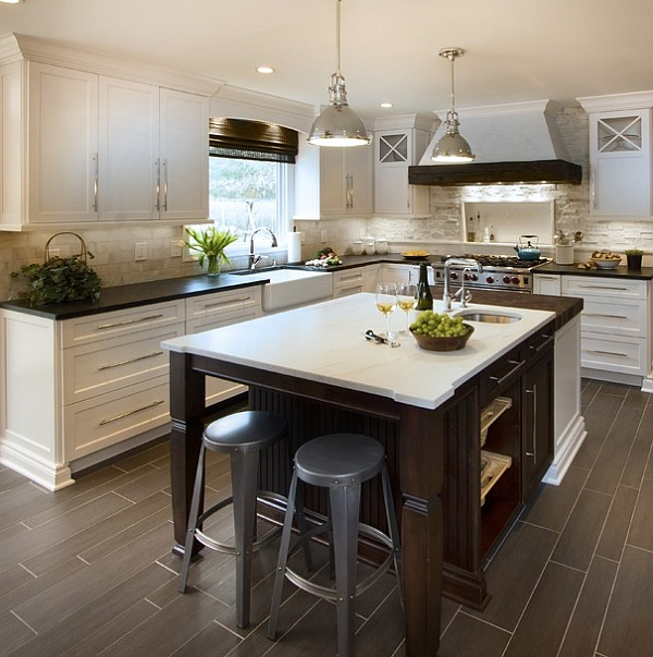 Ergonomic kitchen island design helps in tucking away the bar stools