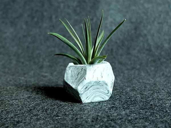 Faceted planter with a marbleized finish