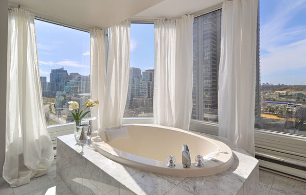 Glamorous bathroom with marble tile