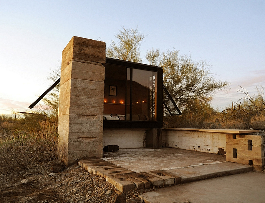 Glass windows offer a view of the world outside1 Miner's Shelter: Tiny Desert Dwelling Clad In Glass And Steel