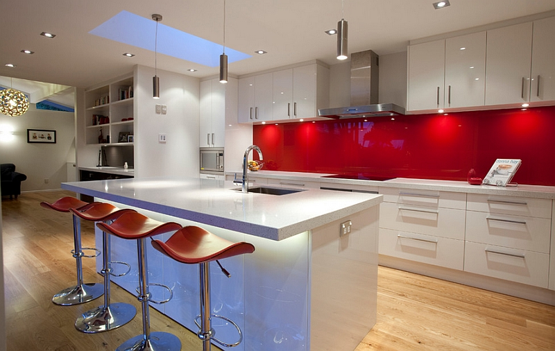 Glossy back painted glass backsplashes in red are both popular and