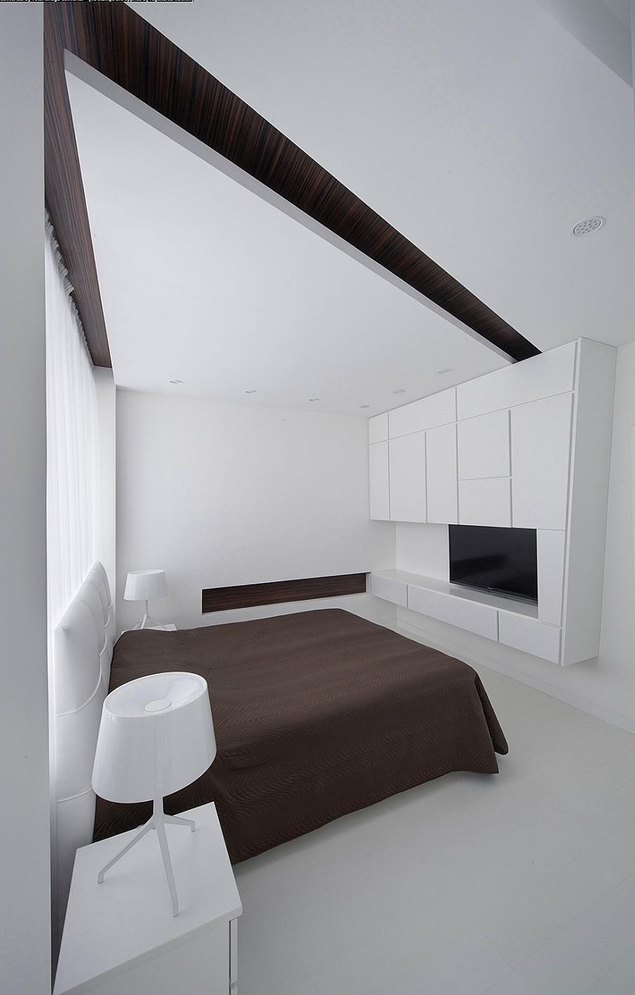 Gorgeous minimalist bedroom in pristine white