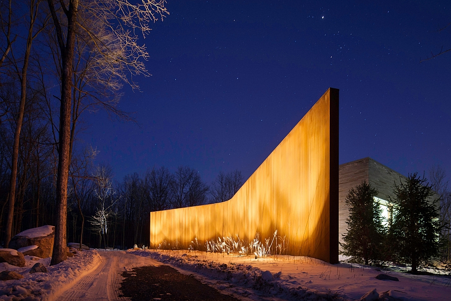 Gorgeously lit wall takes over after sunset Striking Exterior And Sustainable Design Shape The House In The Woods