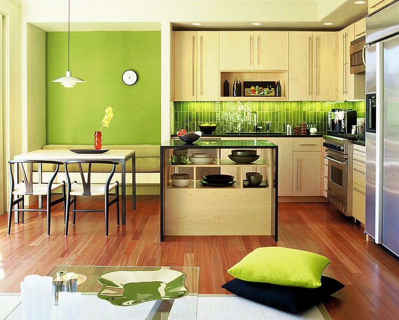 Green makes its presence felt in this lovely modern kitchen