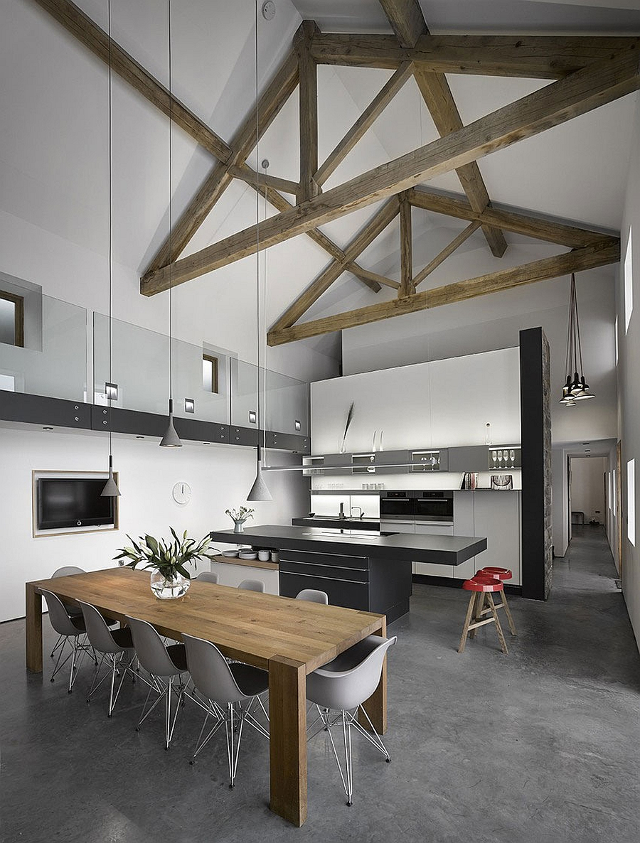 Kitchen island table extension - High Ceilings With Exposed Wooden Beams In Renovated Old English Barn