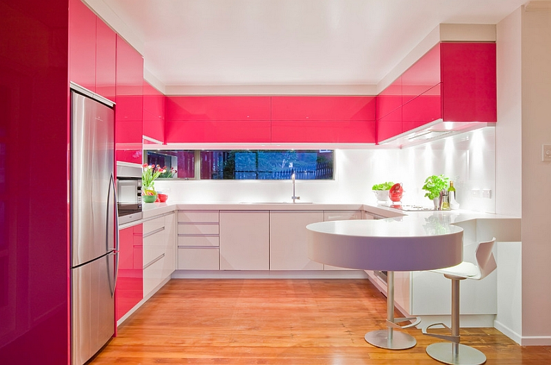 Hot pink lacquer cabinets in a white kitchen