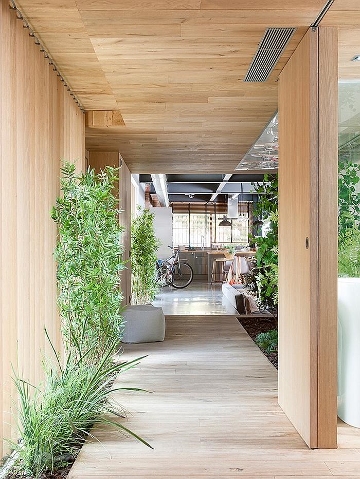 Indoor corridor draped in wood
