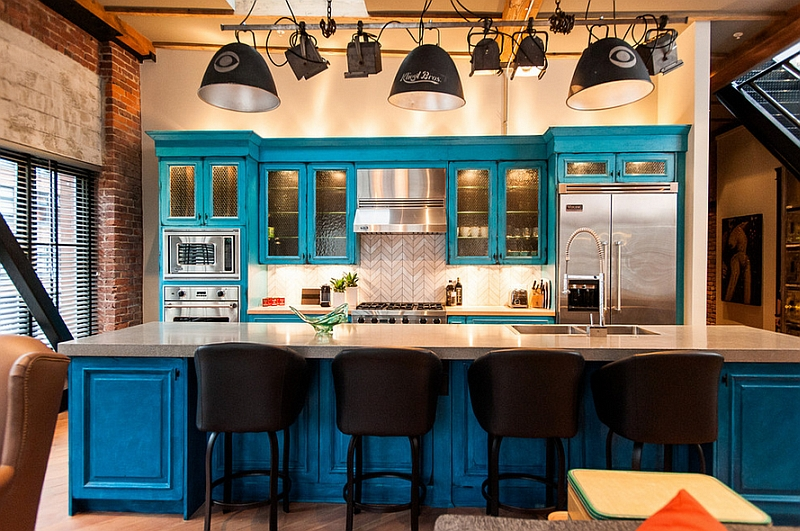 Industrial kitchen with blue cabinets that steal the show