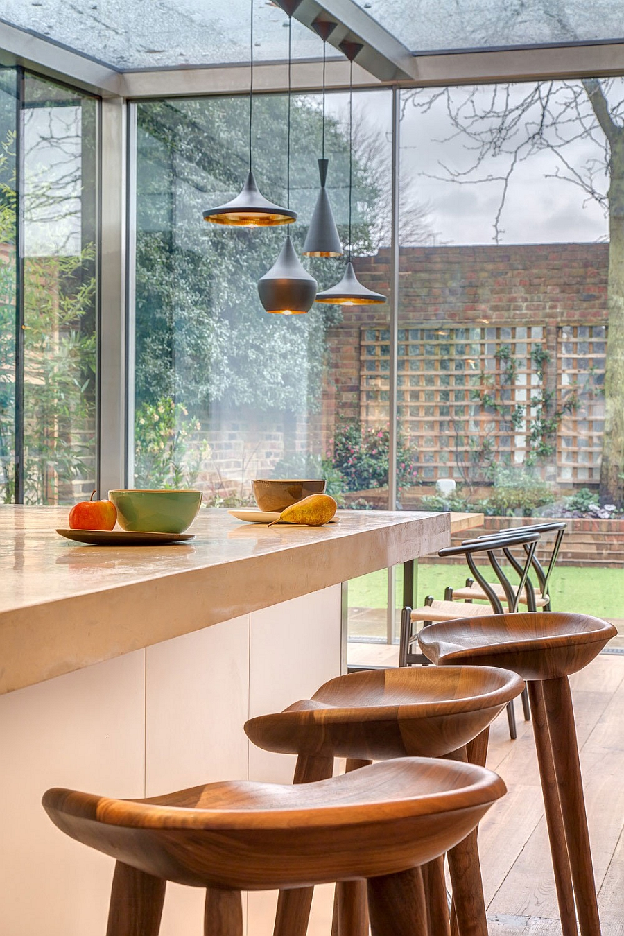 Kitchen and dining areas visually connected with the backyard