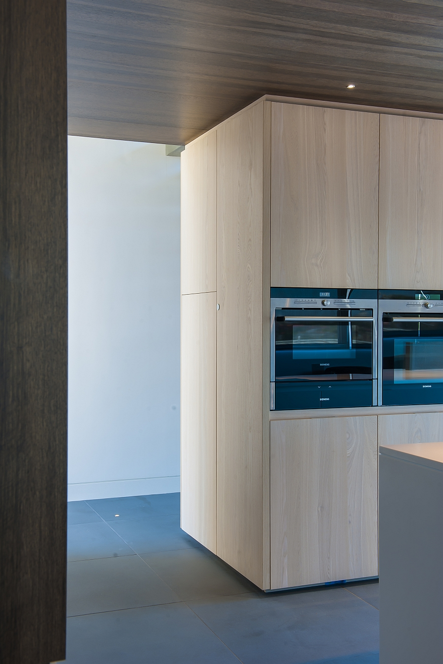 Kitchen appliances along with concealed shelves